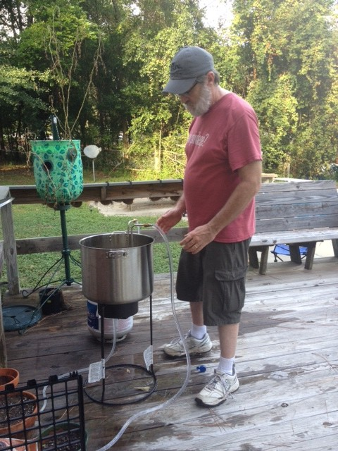 My hubby using the wort chiller to cool the wort.